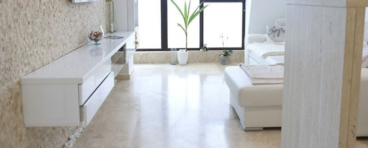 A bright living room home-made with travertine